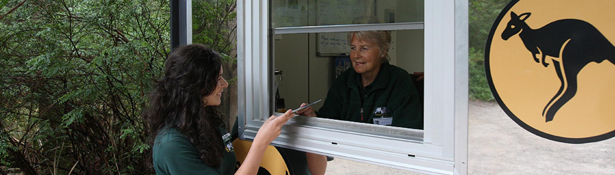Volunteers talking at The Information Booth Healesville Sanctuary