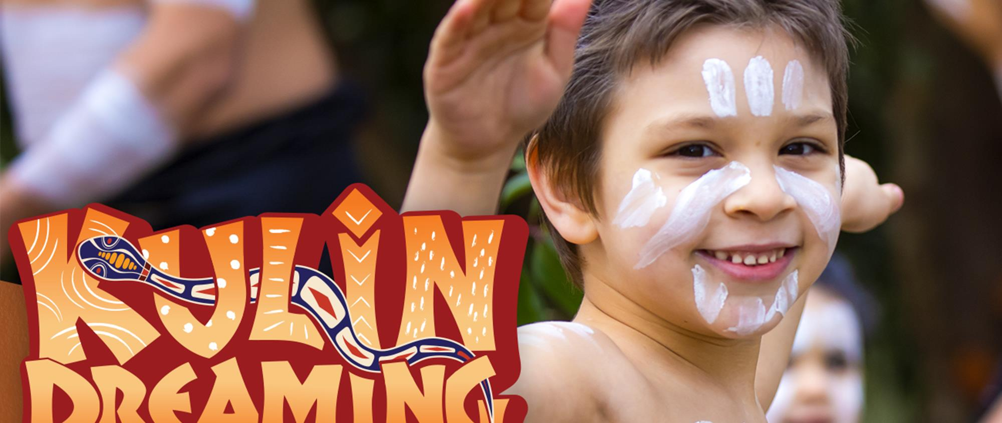 Kulin Dreaming campaign banner. Child dancing with white face paint.