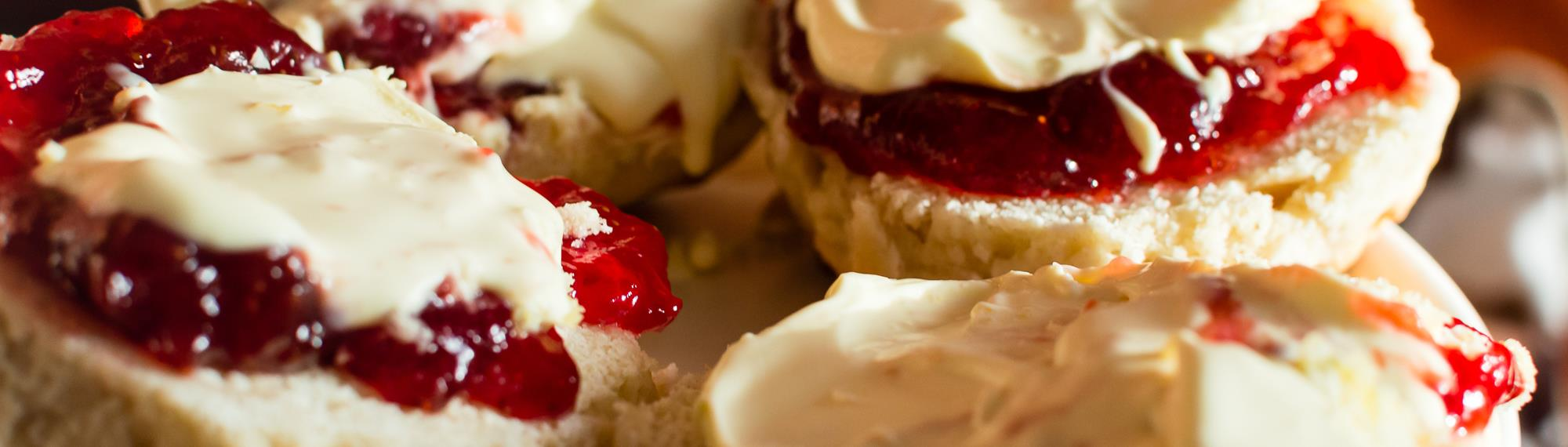 High Tea - delicious fresh scones with jam and cream.