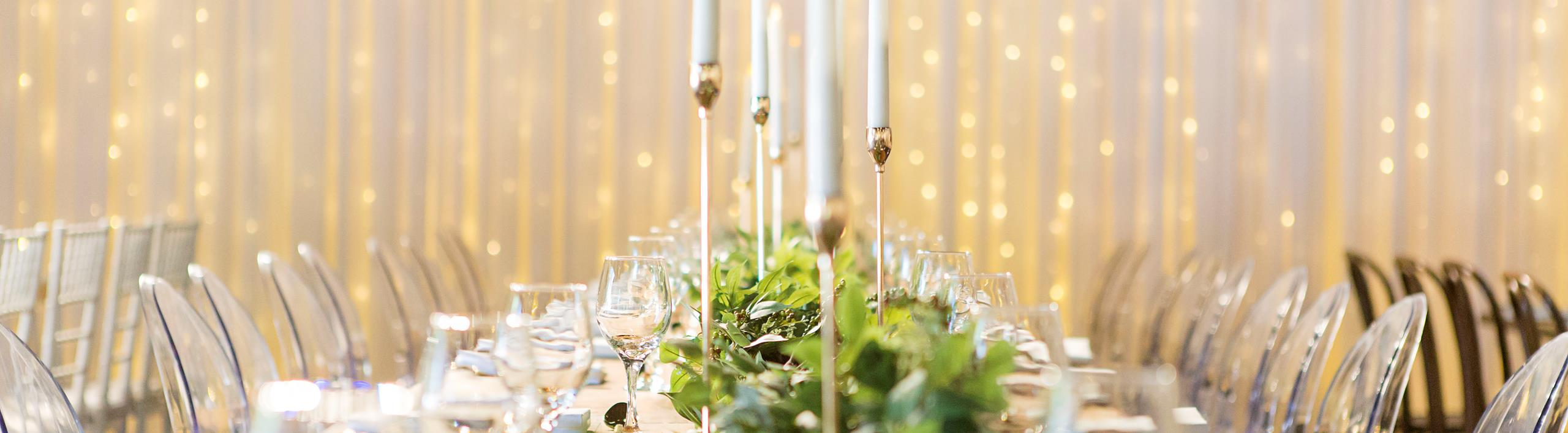 Candles  and elegantly decorated dining table creates a magical setting for a wedding.