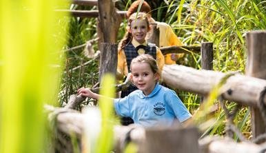 Two primary school girls walking along a path on the Pula Trail at Werribee Open Range Zoo.